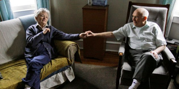 Alzheimer's patient Dorothy Eckert and her husband John Eckert's hold hands at their home in Norristown...