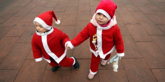 Children dressed as Santa Klaus walk around the Europa entertainment park in the southern German village...