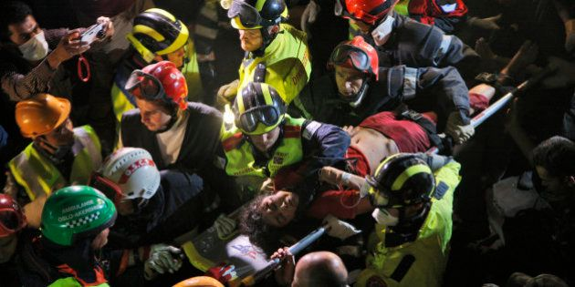 Krishna Devi Khadka is carried on a stretcher after being rescued from a building that collapsed in Saturday's...