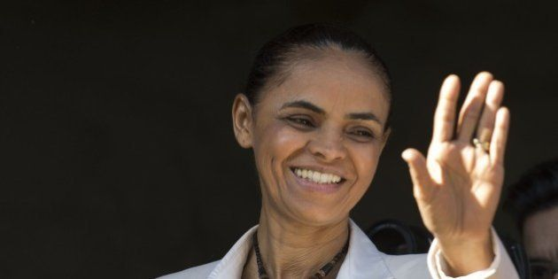 Presidential candidate for the Brazilian Socialist Party, Marina Silva (C), waves to supporters during...
