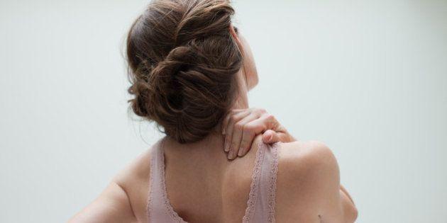 Woman rubbing aching