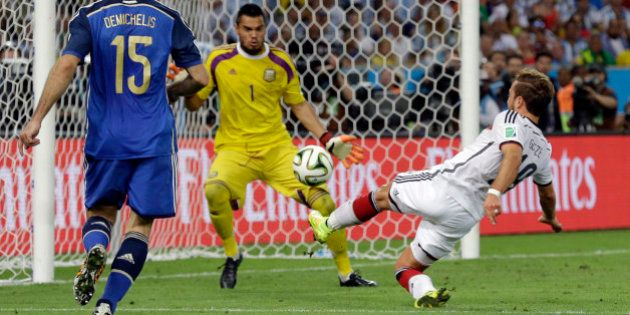 Germany's Mario Goetze, right, scores the opening goal past Argentina's goalkeeper Sergio Romero during...