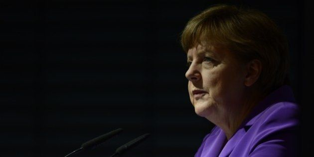 German Chancellor Angela Merkel addresses guests during a forum of the national academies of sciences...