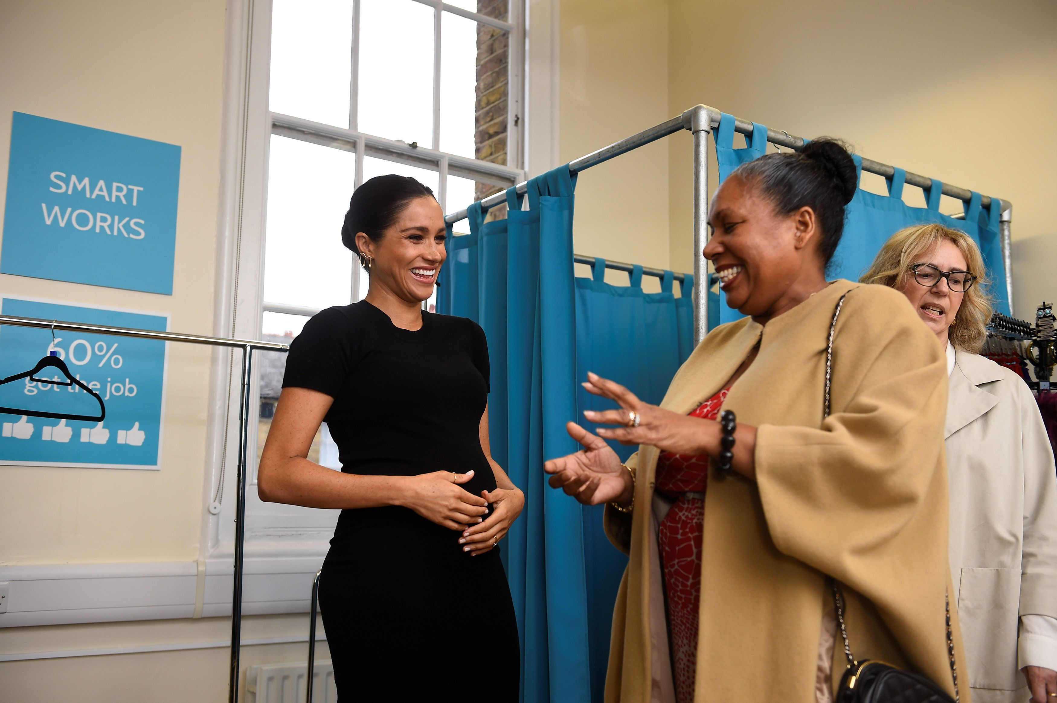 The Duchess of Sussex picks out clothes with Patsy Wardally during her visit to Smart Works, a charity...