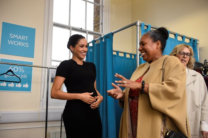 Meghan picks out clothes with Patsy Wardally during her visit to Smart Works at St. Charles Hospital.
