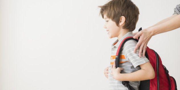 Hispanic mother rushing son to school