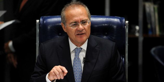 Brazilian senator Renan Calheiros talks before the Federal Senate at the National Congress after being...