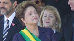 Dilma é recebida com frieza por público em