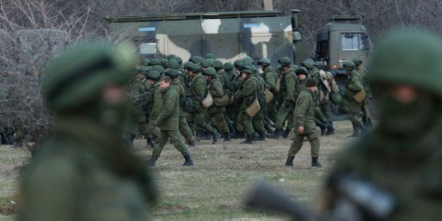 PEREVALNE, UKRAINE - MARCH 05: Troops under Russian command assemble before getting into trucks near...