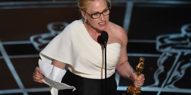 "Patricia Arquette accepts the award for best actress in a supporting role for ""Boyhood"" at the Oscars..."