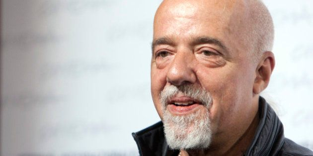 Brazilian writer Paulo Coelho poses during a photocall for the presentation of the
