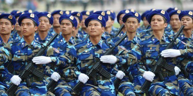 Maritime policemen parade during official celebrations of the 60th anniversary of Vietnam's Dien Bien...