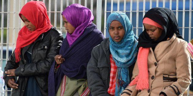 LAMPEDUSA, ITALY - FEBRUARY 20: Migrants wait to board a ship on February 20, 2015 in Lampedusa, Italy....