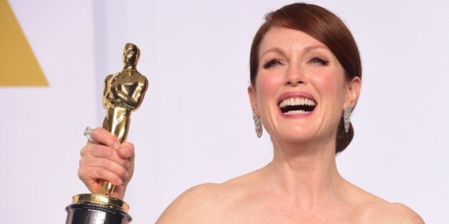 Actress Julianne Moore, winner for the Best Actress in a Leading Role Award for 'Still Alice' poses in...