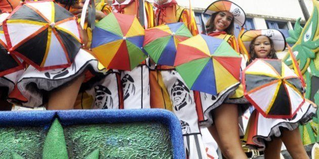 Frevo dancers perform with the Galo da Madrugada street carnival band on February 18, 2012 in Recife,...