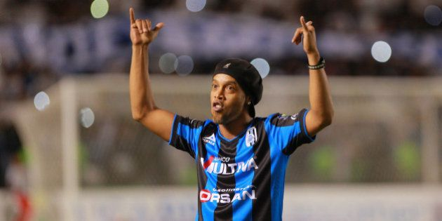 QUERETARO, MEXICO - SEPTEMBER 12: Ronaldinho greets the fans during the football match between Gallos...