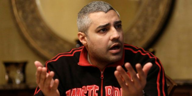 Canadian Al-Jazeera English journalist Mohamed Fahmy, speaks during an interview with The Associated...