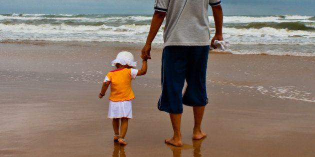 Antony and Lisa at Baga beach, Goa on rainy evening
