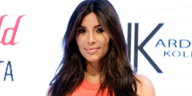 SYDNEY, AUSTRALIA - SEPTEMBER 13:  Kim Kardashian attends the Kardashian Kollection Spring Launch at Westfield Parramatta on September 13, 2014 in Sydney, Australia.  (Photo by Lisa Maree Williams/Getty Images)