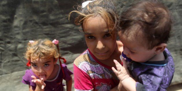 Iraqi children, who fled with their families the city of Ramadi after it was seized by Islamic State...