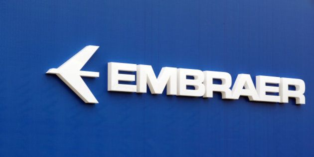 The logo of Brazil's aircraft manufacturer Embraer taken at Le Bourget airport, near Paris on June 23,...
