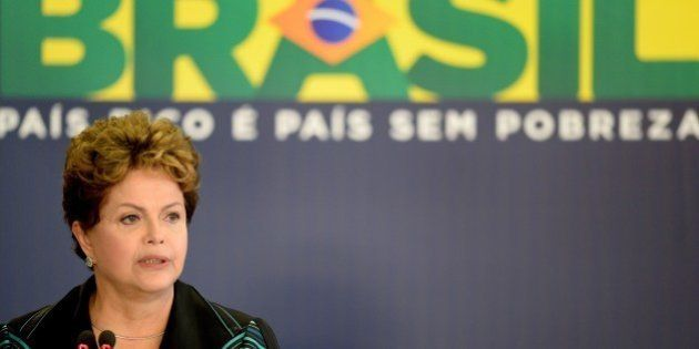 Brazilian President Dilma Rousseff delivers a speech during the ceremony presenting the final report...