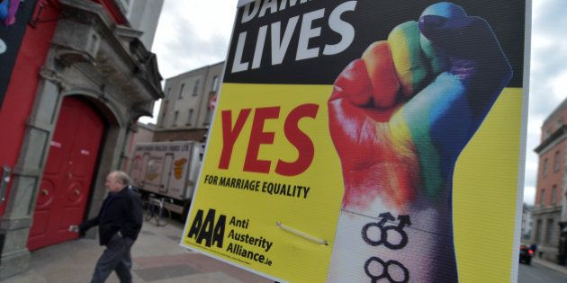 DUBLIN, IRELAND - MAY 22: A man walks past billboard posters promoting the Yes campaign in favour of...
