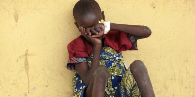 A girl rescued from Boko Haram's hides her face at the Malkohi camp for internally displaced persons...