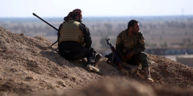 Iraqi Shiite fighters from the Popular Mobilization units hold a position on April 14, 2015 in the Garma...