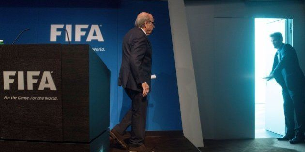 FIFA President Sepp Blatter leaves after a press conference at the headquarters of the world's football...