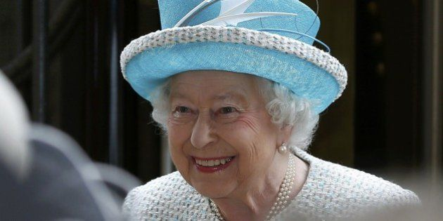 Britain's Queen Elizabeth II smiles as she arrives at Lancaster railway station in Lancaster, northern...