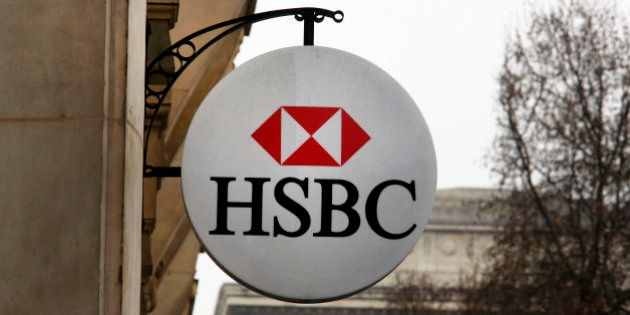 The logo of British bank HSBC is visible on the facade of HSBC France headquarters on the Champs Elysees...