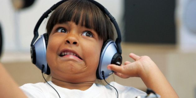 SAN FRANCISCO - JULY 14: Six-year-old Emma Cordell reacts as she listens to a new iPod on display at...