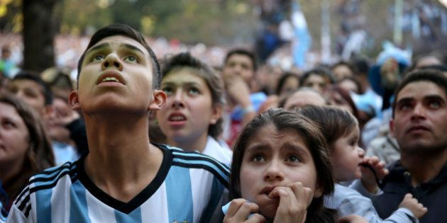BUENOS AIRES, ARGENTINA - JULY 13: Argentine soccer fans watch a broadcast of their team playing Germany...