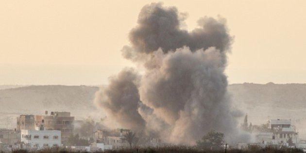 A picture taken from the Israel-Gaza border shows smoke rising from the coastal side of the Gaza strip...