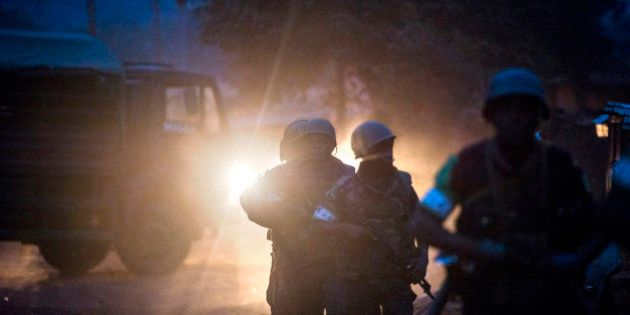 MISCA military soldiers take position during an operation in the Boy-rabe neighborhood of Bangui, Central...