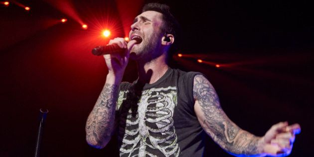 MADRID, SPAIN - JUNE 15: Singer Adam Levine of Maroon 5 performs on stage at the Barclays Center on June...