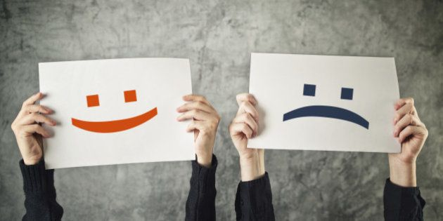 Happy and sad face. Women holding papers with happy and sad