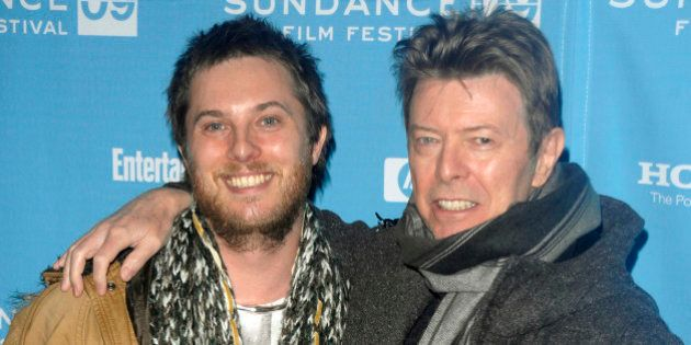 Director Duncan Jones and singer David Bowie attend the premiere