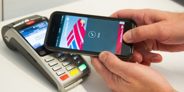IMAGE DISTRIBUTED FOR MASTERCARD - MasterCard demonstrates Apple Pay at the launch of MasterCard's NYC...