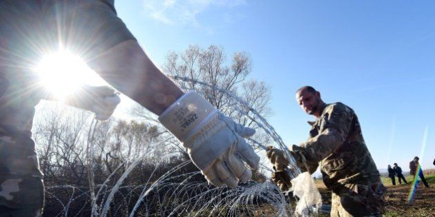 Slovenian soldiers set barbed wire fences on the Slovenian-Croatian border near Rakovec on November 12,...