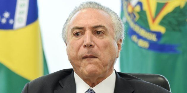Brazilian acting President Michel Temer speaks during a meeting with leaders of allied parties in the...