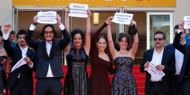 Director Kleber Mendonca Filho (R) and cast members Maeve Jinkings (3rdL), Sonia Braga (C), producer...