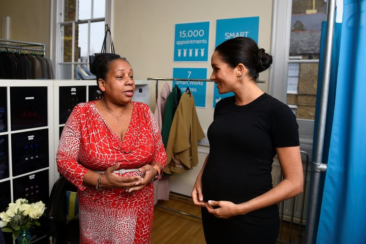 The Duchess of Sussex chats with Patsy Wardally as they pick out clothes.