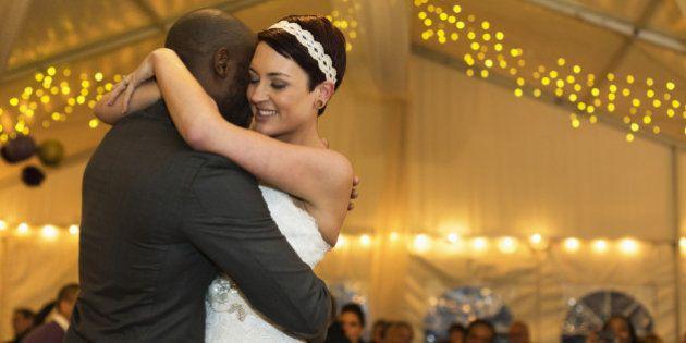 Newlywed couple dancing at