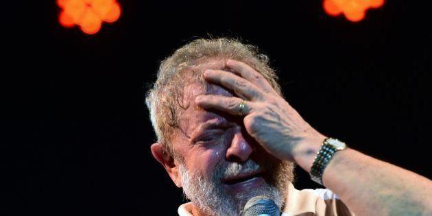 Brazilian former President (2003-2011) Luiz Inacio Lula Da Silva gestures as he delivers a speech during...
