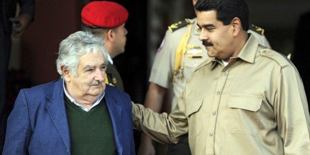 Venezuelan President Nicolas Maduro (R) greets his Uruguayan counterpart Jose 'Pepe' Mujica during an...