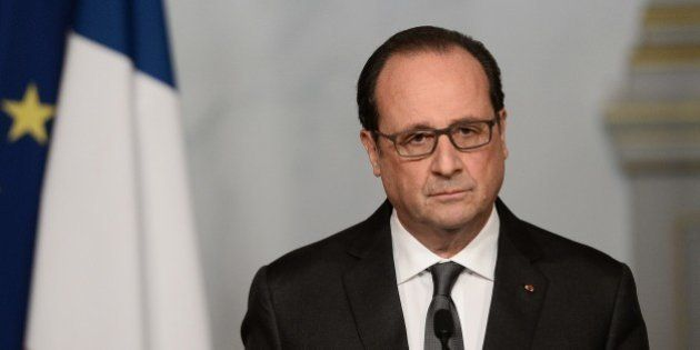 French president Francois Hollande speaks at the Elysee palace in Paris on November 14, 2015, following...