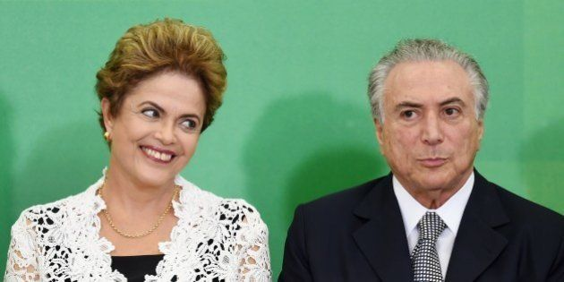 Brazilian President Dilma Rousseff (L) and her Vice-President Michel Temer attend the inauguration ceremony...