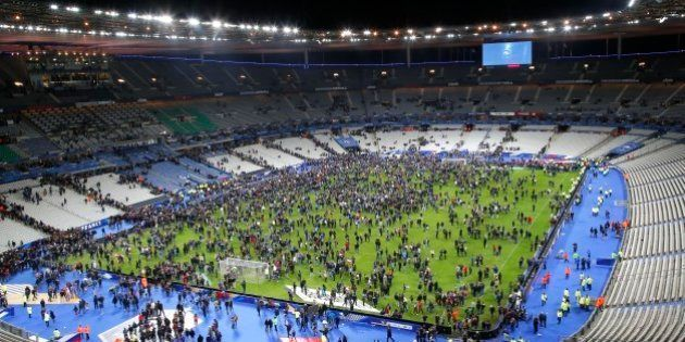 Spectators invade the pitch of the Stade de France stadium after the international friendly soccer France...
